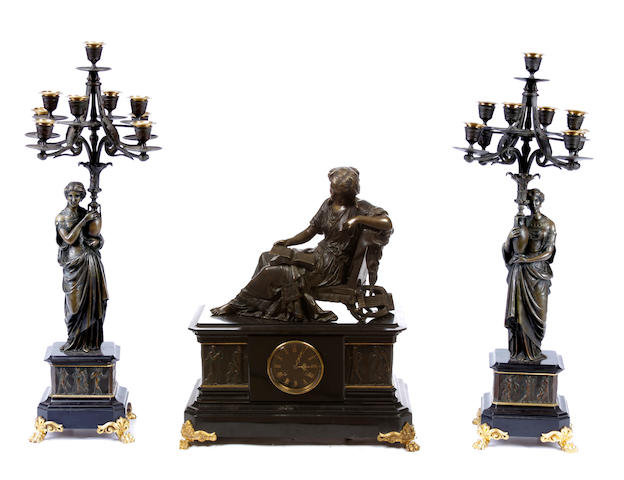 A Neoclassical style gilt and patinated bronze clock garniture