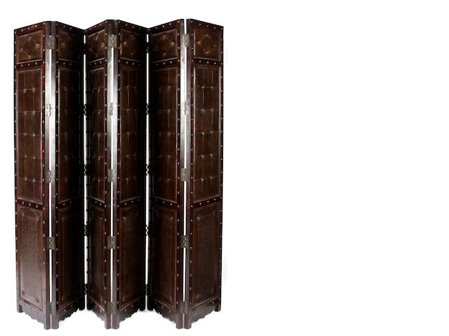 A Portuguese Baroque style oak and leather six panel screen