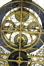 An unusual French silvered and gilt brass great wheel skeleton timepiece with day, date and lunar calendar Early 19th century