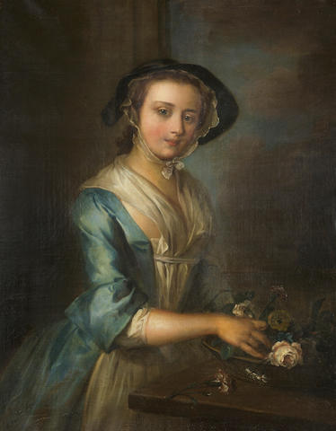 Attributed to Henry Robert Morland (circa 1716-1797 London) A young woman arranging flowers 36 x 28in (91.4 x 71.1cm)