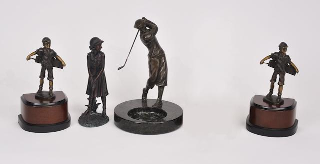 A group of four patinated metal and composition figures of golfers and caddies<BR />late 20th century