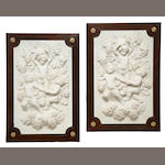 A pair of Louis XVI style marble relief plaques within gilt bronze mounted walnut frames