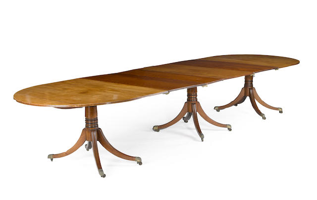 A George III mahogany three pedestal dining table<BR />late 18th/early 19th century