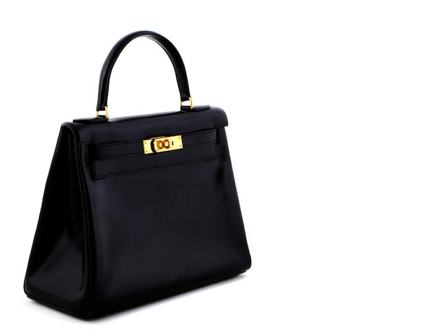 An Hermès small black Kelly handbag<BR />date code for 1973