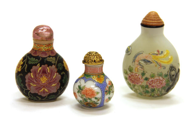 Three modern enameled glass bottles