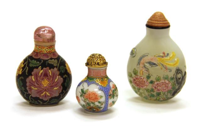 Three modern enameled glass bottles