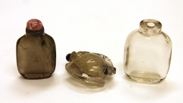 A group of three rock crystal bottles 1800-1880