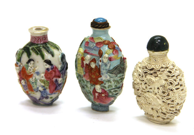 A group of three molded porcelain snuff bottles