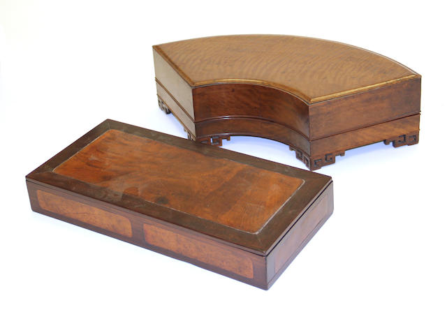 Two wooden covered boxes