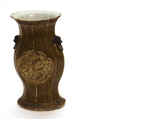 An olive-glazed porcelain vase with dragon motifs