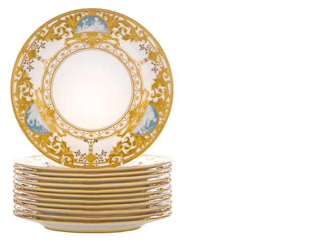 Twelve Minton pâte-sur-pâte porcelain plates<BR />Albion Birks (c. 1862-1941)<BR />retailed by Spaulding & Co., Chicago<BR /> date code for 1910