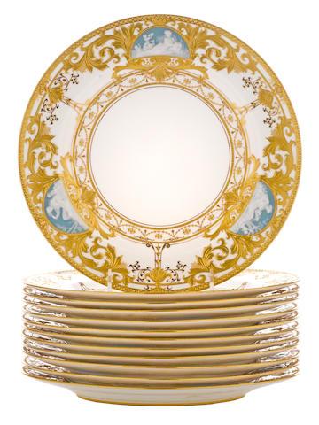 Twelve Minton pâte-sur-pâte porcelain plates<BR />Albion Birks (c. 1862-1941)<BR />retailed by Spaulding & Co., Chicago<BR /> date code for 1910