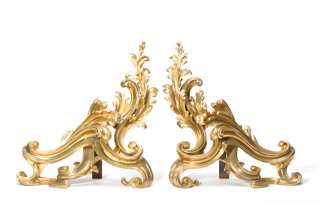 A pair of Louis XV style gilt bronze chenets<BR />late 19th century
