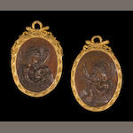 A pair of Belle Époque oval relief cast patinated bronze plaques within gilt bronze frames <BR />after A.D. Saϊbas (Europe, 19th century)<BR />late 19th century