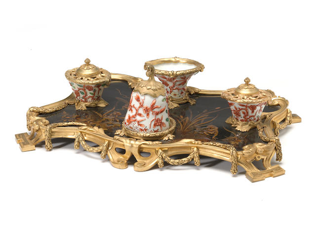 A Louis XV style gilt bronze and porcelain mounted lacquer encrier <BR />late 19th/early 20th century