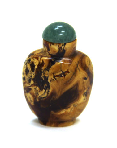 An amber snuff bottle