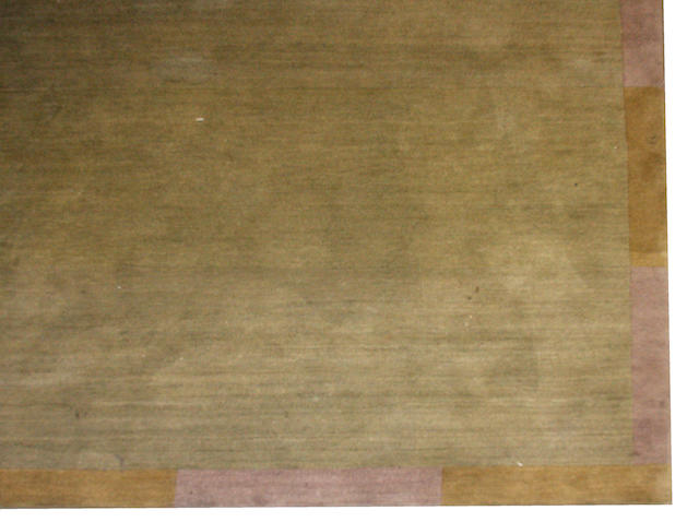 A Tibetan rug  size approximately 16ft 9in x 14ft 9in