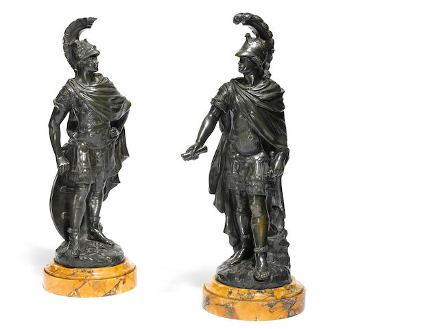A pair of French patinated bronze figures of Roman nobleman