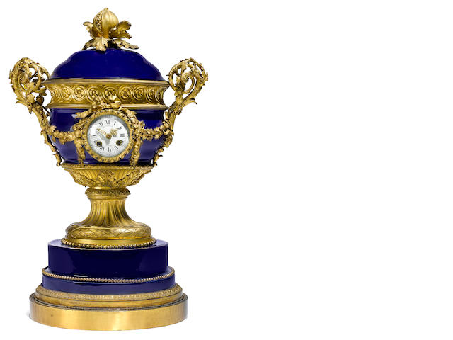 A good quality French gilt bronze mounted porcelain urn form clock, now as a table lamp