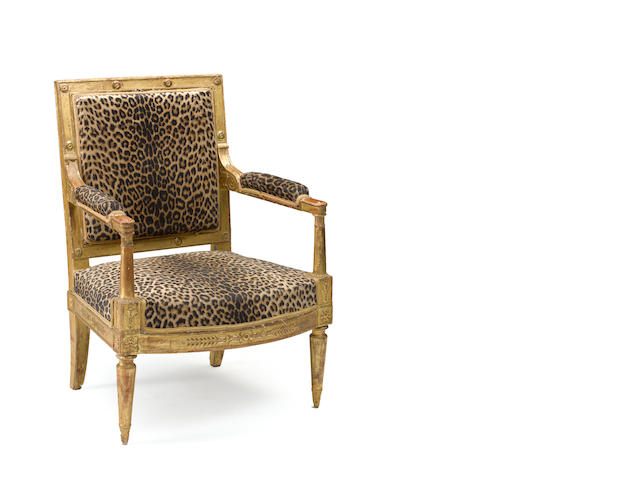 An Empire giltwood fauteuil a la reine<BR />early 19th century<BR />with inventory mark for Louis, Duc de Bourbon and Prince du CondeLB beneath a crown