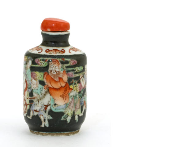 A porcelain snuff bottle with famille rose enamel decoration on a black ground