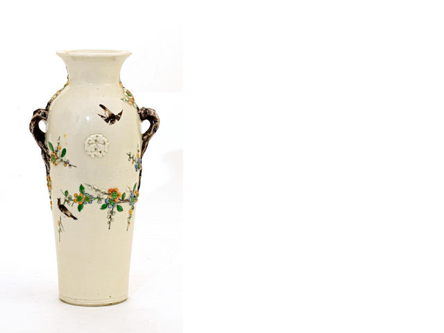 A cream glazed porcelain baluster vase with famille verte enamel decoration