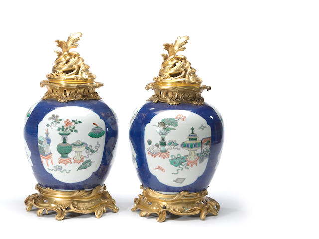 A pair of Chinese porcelain jars with Louis XV style gilt bronze mounts<BR />late 19th century