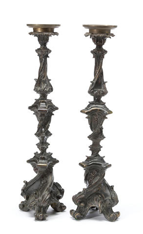 A pair of Baroque style patinated bronze candle torchères<BR />19th century