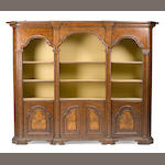 An Italian Baroque style walnut and mixed wood bibliotheque 20th century