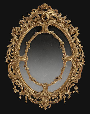 A Napoleon III giltwood and gilt composition oval mirror <BR />third quarter 19th century