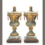 A pair of Régence style gilt bronze mounted variegated green marble urns<BR />late 19th century
