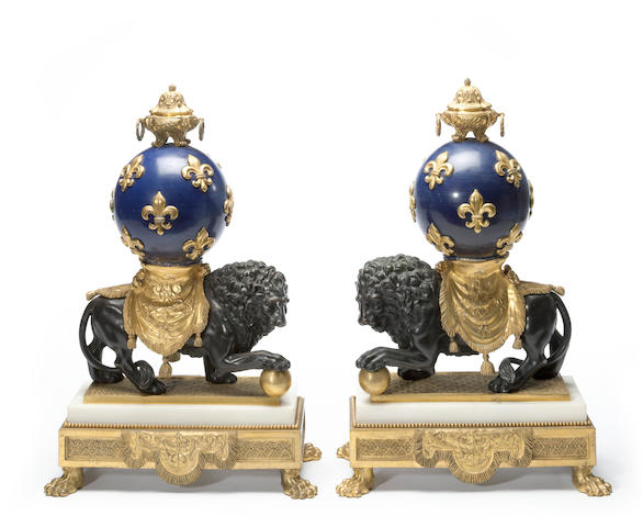 A pair of Régence style gilt, patinated bronze, enamel and marble figural chenets<BR />late 19th century