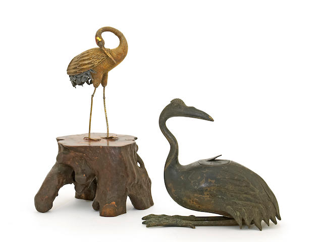 Two Asian crane figures