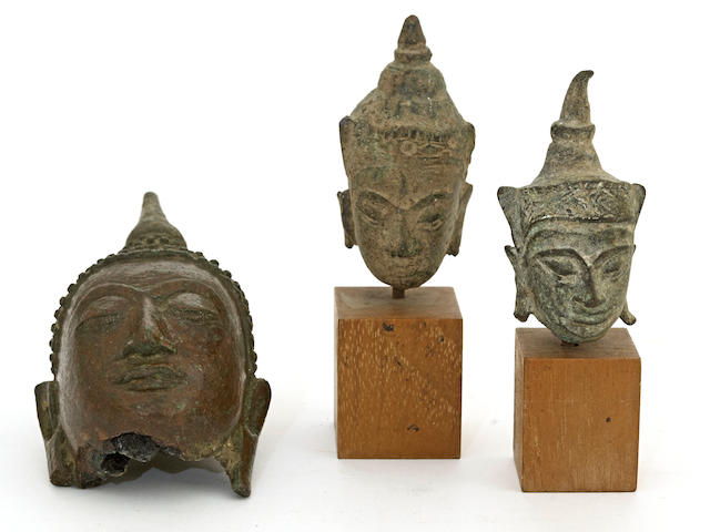 A group of three Thai bronze Buddha heads