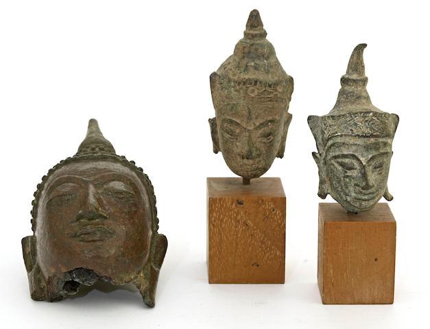 A group of three Thai bronze Buddha heads