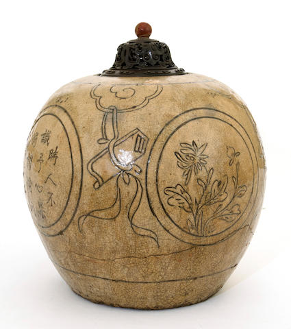 A Chinese slip glazed pottery jar with incised decoration