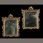 A pair of Italian Rococo silver gilt mirrors<BR /> third quarter 18th century