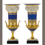 A pair of Paris porcelain floral encrusted two handled urns <BR /> second quarter 19th century
