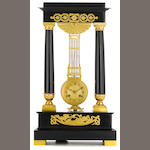 A Louis Philippe gilt bronze mounted ebonized wood suspended movement portico clock<BR />second quarter 19th century