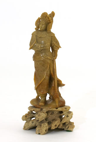 A soapstone standing figure