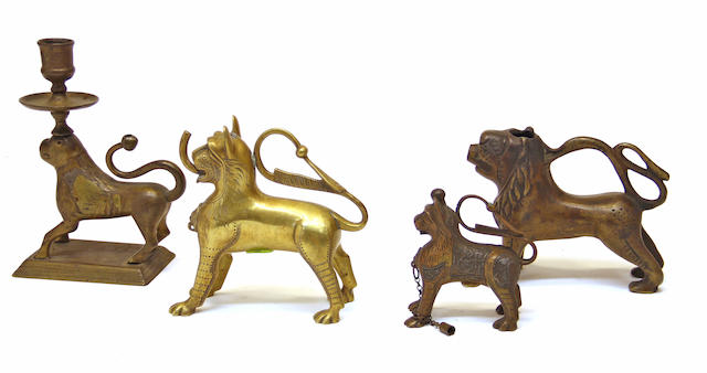 A small bronze aquamanile modeled as a lion in the 13th century German style and three similar examples  19th and 20th century