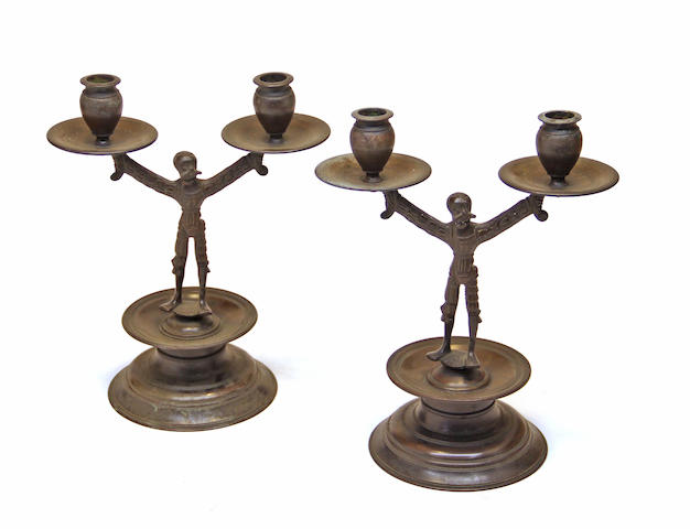 A pair of patinated bronze figural candelabra in the 16th century German style 19th century