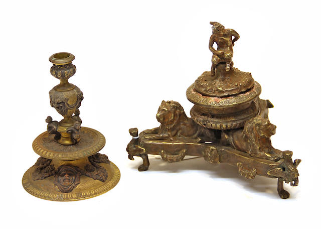 A Renaissance style patinated bronze figural inkwell and a candlestick late 19th/early 20th century