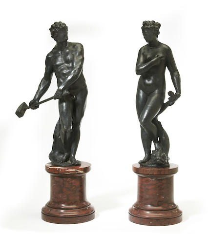 A pair of Renaissance style patinated bronze and rouge griotte figures: Venus and Thor   first half 20th century