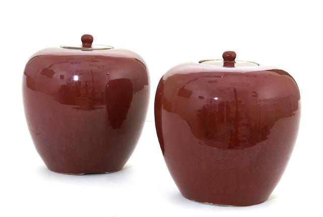 A pair of transmutation red glazed porcelain jars and covers  Late Qing/Republic period