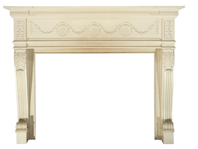 A George II style painted and carved fireplace surround<BR />first quarter 20th century