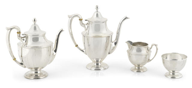 An American  sterling silver  four piece tea and coffee service Dunkirk Silversmiths, Inc., Meriden, CT,  mid-20th century
