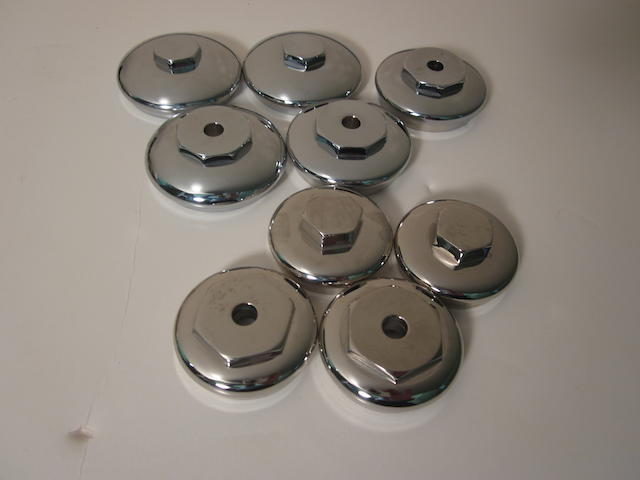 A grouping of reproduction pre-war Rolls-Royce radiator caps,