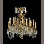 A Louis XV style gilt bronze and glass twenty-four light chandelier <BR />fourth quarter 19th century