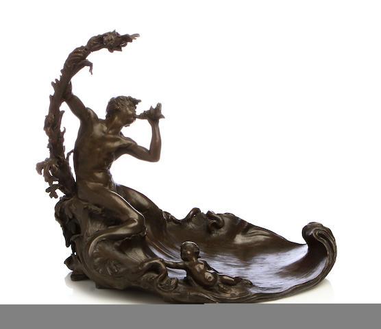 A patinated bronze figural vide poche